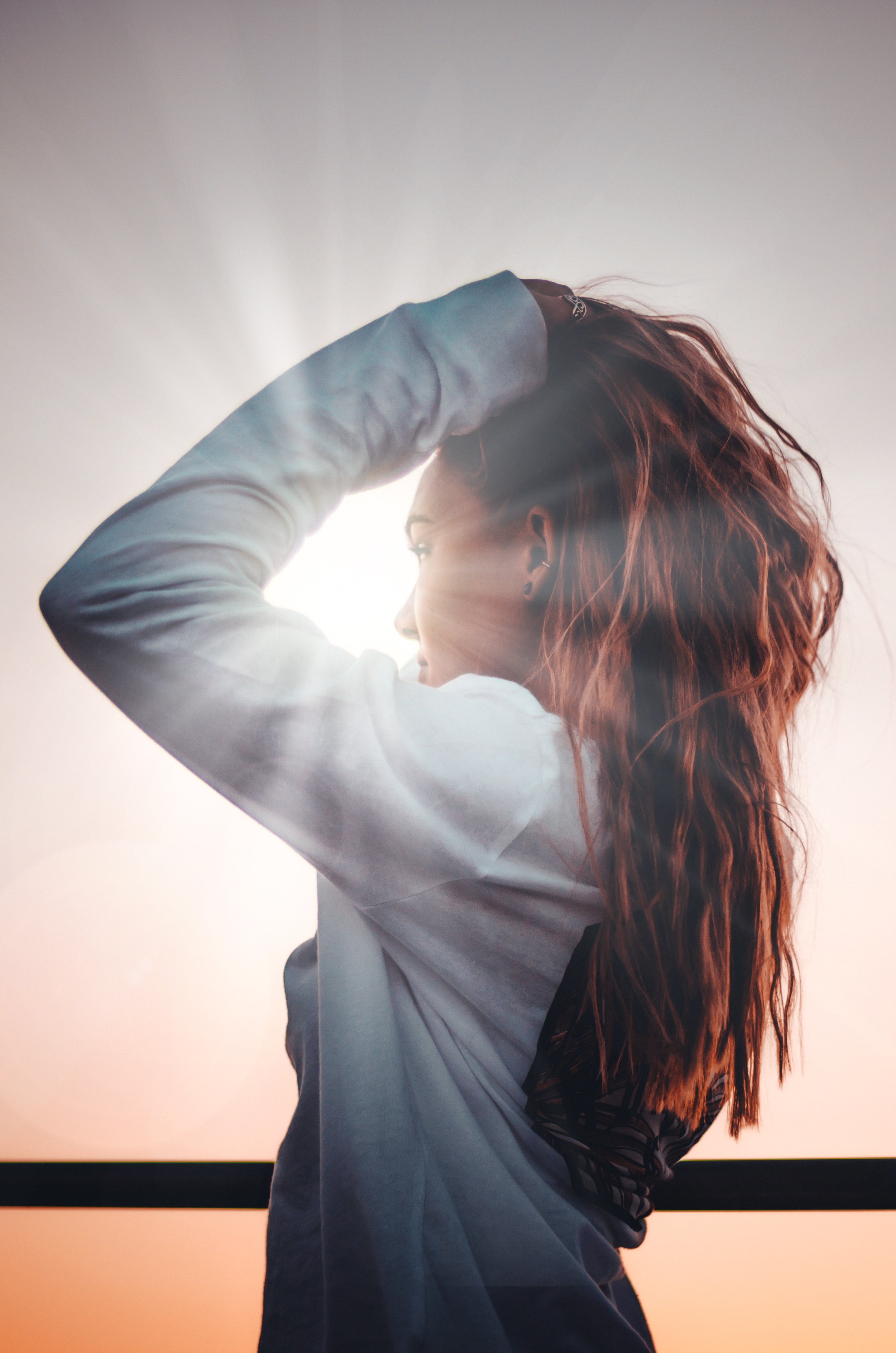 Woman Holding Hair in Natural Light